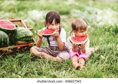 The Little girl eating watermelon.