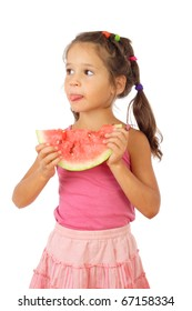 Little girl eating watermelon, sticking out tongue, studio shoot