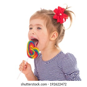 Little girl eats a big Lollipop