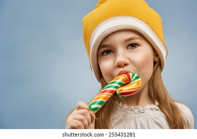 little girl eats a candy bar