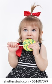 Little girl eats sweets prohibited  for her