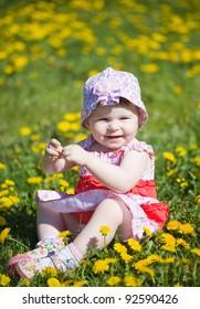little girl in an elegant sundress in city park on walk
