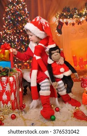 Little girl elf, Santa Claus with a monkey