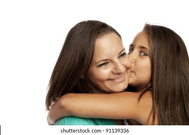 Little girl embracing and kissing her mother
