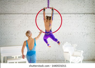 a little girl engaged in aerial gymnastics.