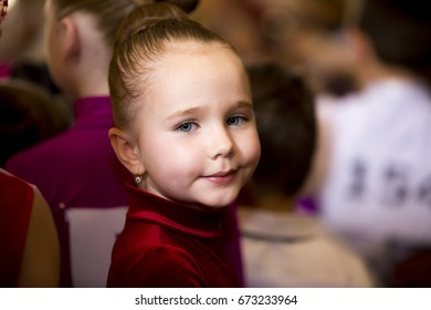 Little girl is engaged in ballroom dancing