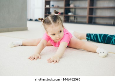 little girl engaged in recreational gymnastics. sports exercises and stretching: athletics
