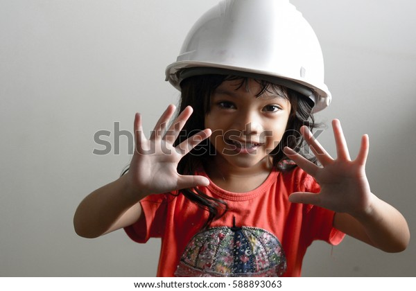 Little girl Engineer in the construction with white helmet