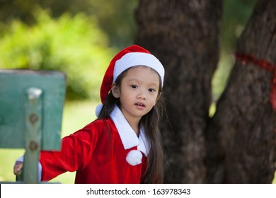 Little girl enjoy dressing as santa
