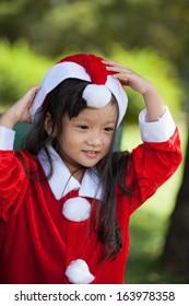 Little girl enjoy dressing as santa