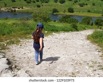 Little girl enjoying day out activity walking hiking in nature