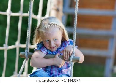 Little girl is enjoying herself at playground