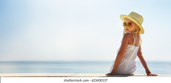 Little girl enjoying summer vacation at the sea