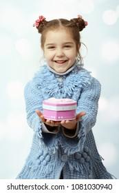 Little girl enjoys the gift