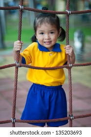 little girl enjoys playing playground