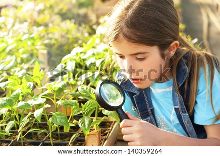 little girl explores the nature