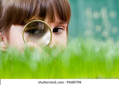 Little girl exploring the grass