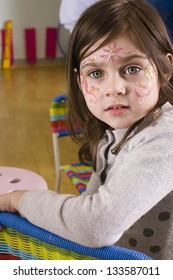 little girl with faceart on birthday party