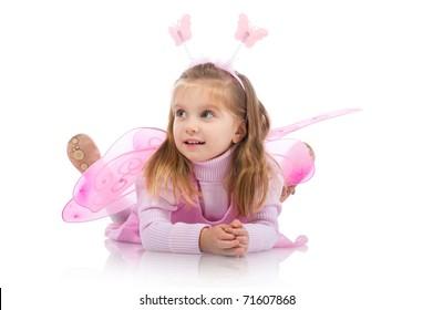 Little girl in fairy costume on white background