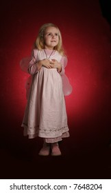 little girl with fairy wings -  over red