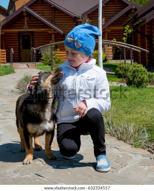 little girl with faithful dog