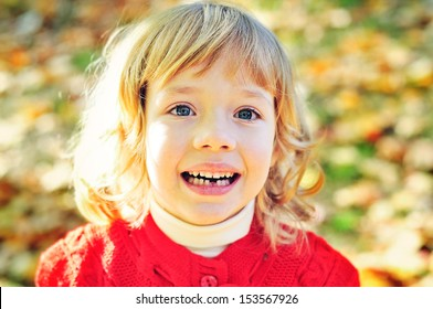 little girl in fall missing her first tooth