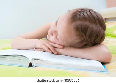 little girl fallen asleep reading her favourite book