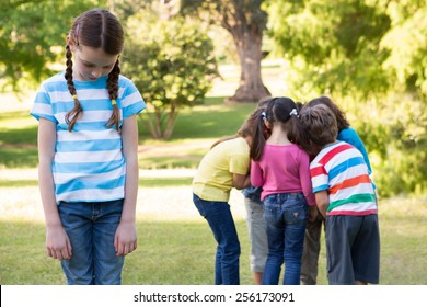 Little girl feeling left out in park on a sunny day