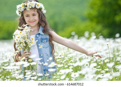 Little girl in a field with flowers