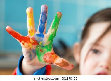 A little girl fingerpainting