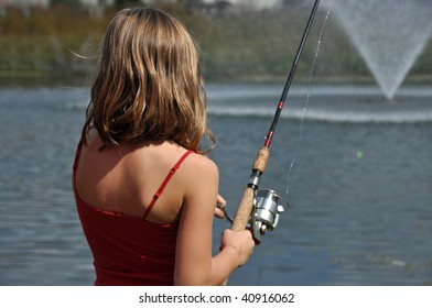 a little girl fishing at the pond on a summer day