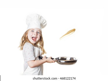 A little girl flipping a pancake