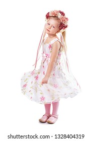 little girl in flower dress and wreath isolated