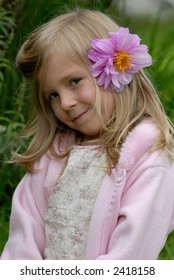 the little girl with a flower in hair