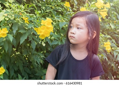 little girl and flowers at home.