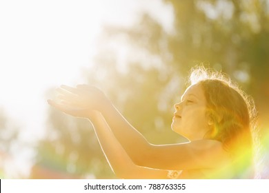 Little girl folded her hand in praying. Peace, hope, dreams concept.