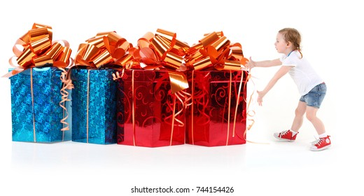 Little girl and four red and blue gift boxes on white, collage