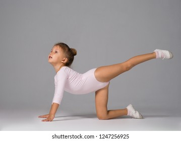 The little girl of four years is engaged in gymnastics