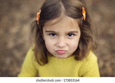 Little Girl Frowning