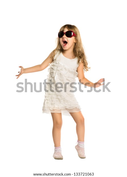 The little girl fun dancing in the glasses, isolated on white background