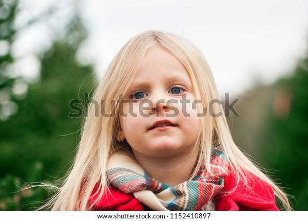 Little girl in fur tree farm