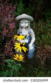 Little Girl Garden Statue Surrounded by Wildflowers
