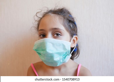 Little girl in a gauze mask