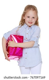 Little girl with a gift. The concept of a family holiday, Christmas, birthday. isolated on white background