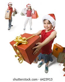 little girl giving a present to someone, while other childs waits behind her.