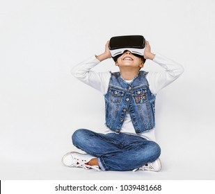 Little girl with glasses of virtual reality. Future gadgets technology concept