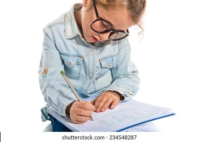 Little girl with glasses writing