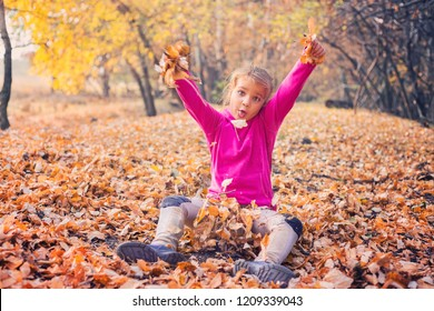 Little girl goofing around and playing in the forest