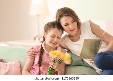Little girl greeting her mother at home