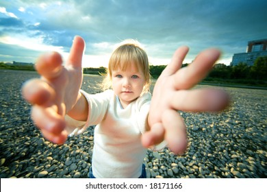 little girl grief look and reach out hands